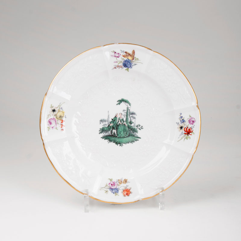 A plate with green Watteau painting