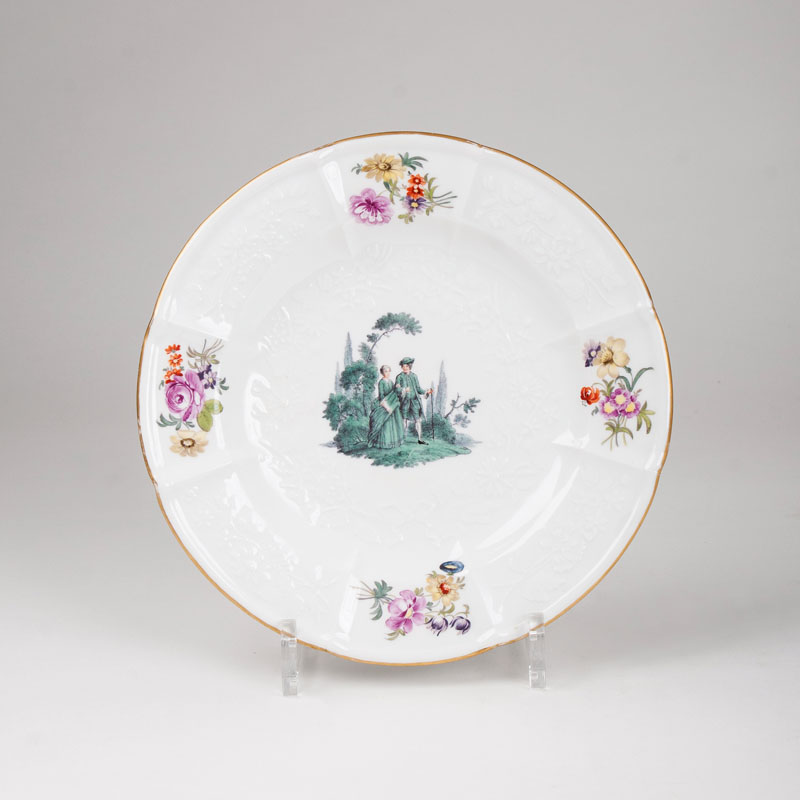A plate with green Watteau-painting
