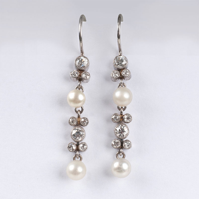 A pair of petite seedpearl earrings with old cut diamonds