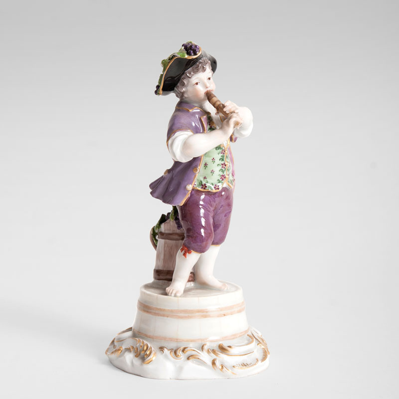 A porcelain figure 'gardener child playing the flute'