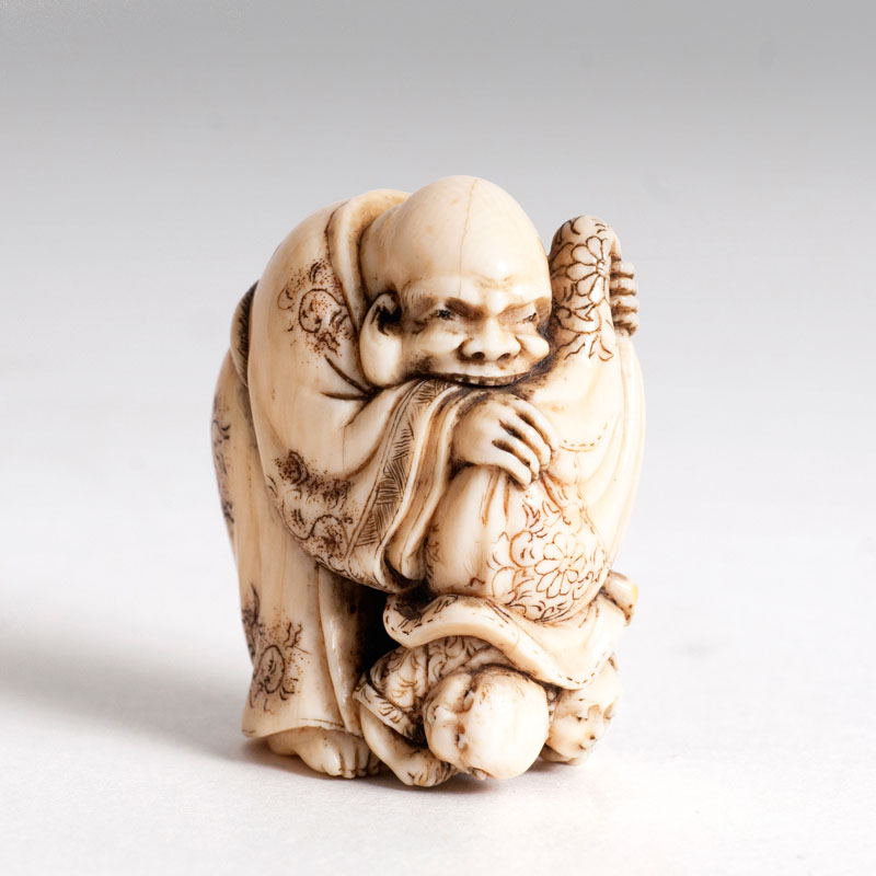 A netsuke 'children out of the bag'