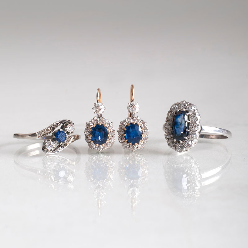 A pair of saphire diamond earrings and two sapphire diamond rings