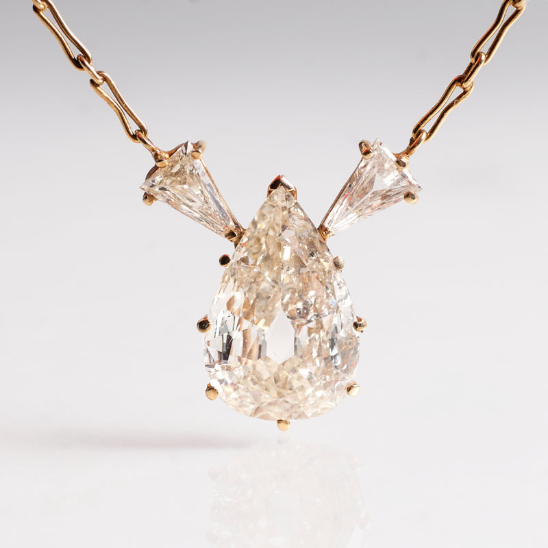 A large fancy diamond as pendant with necklace