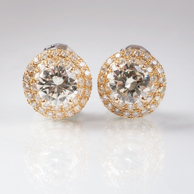 A pair of great solitaire diamond earclips