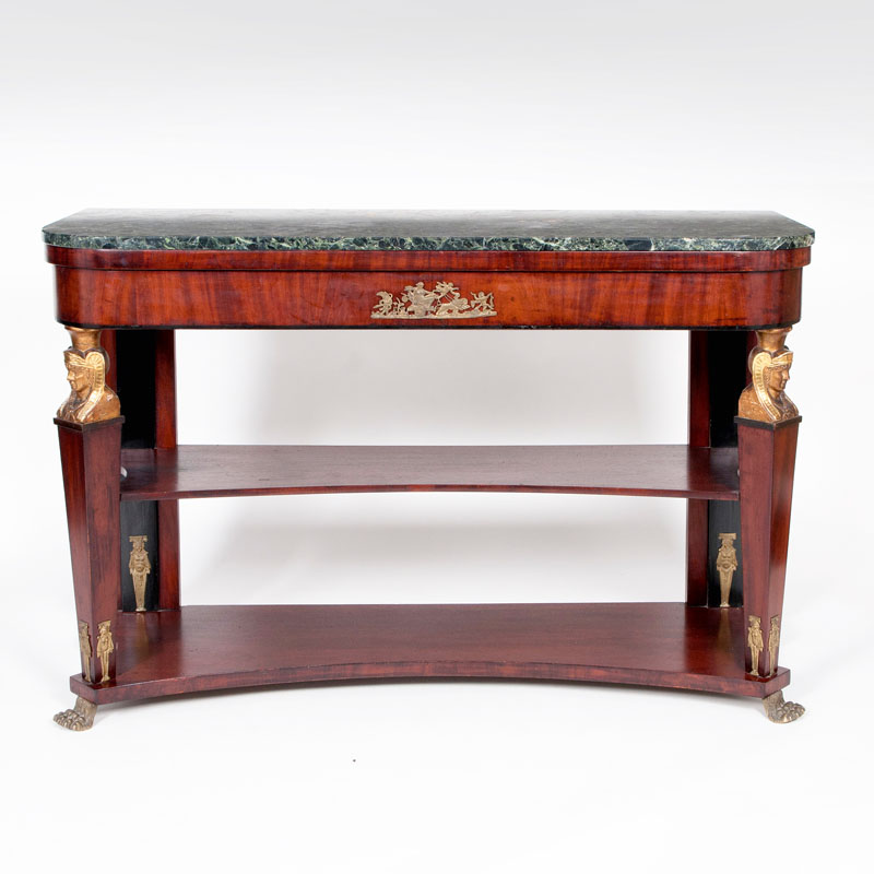 An Empire style console table with sphinx decor