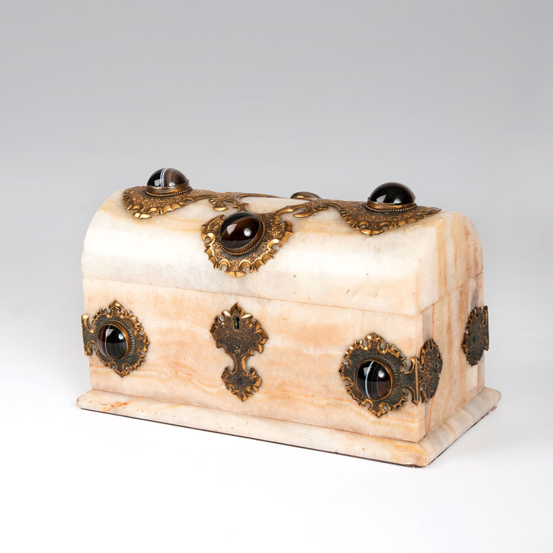 An alabaster casket with agate cabochons