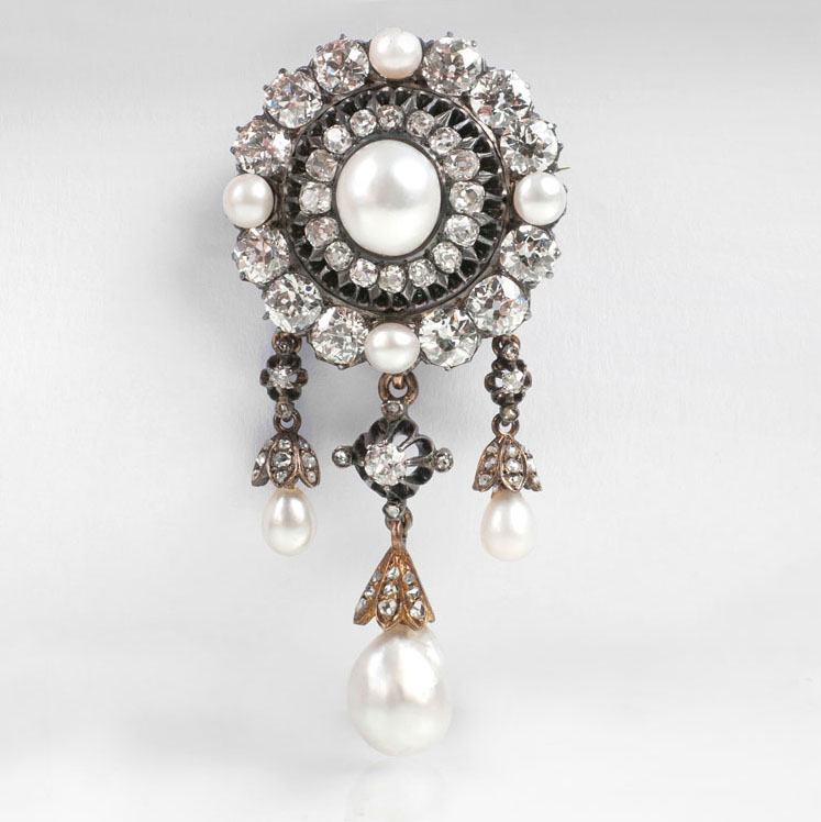 A fin-de-siècle diamond brooch with natural pearls