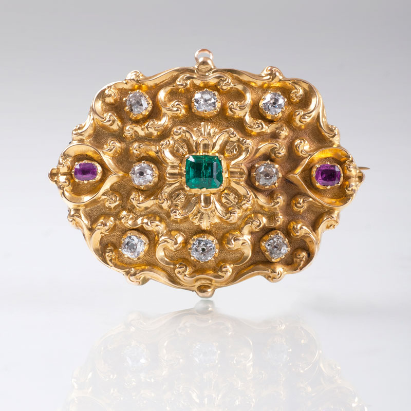 A golden pendant with old cut diamonds, rubies and emerald