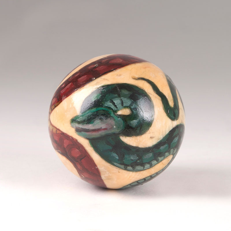 A billiard ball with snake motif