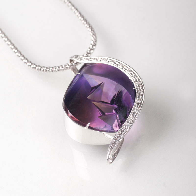 A modern amethyst diamond pendant with necklace