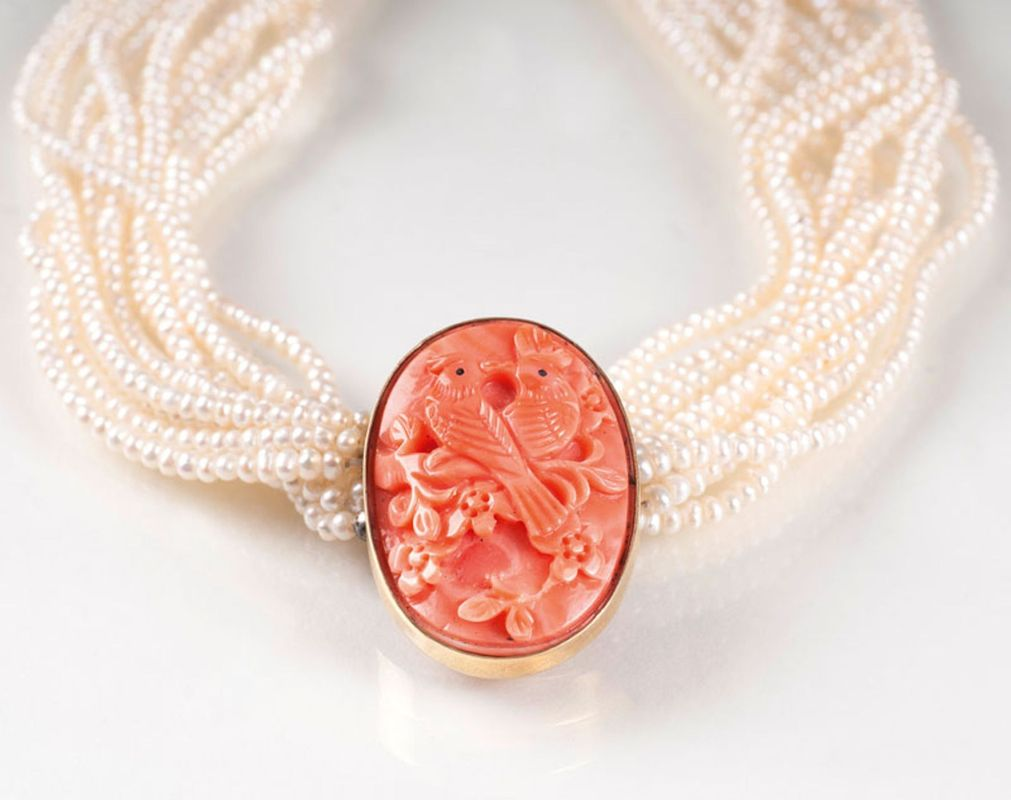 A pearl necklace with coral clasp