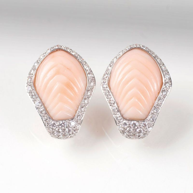 A pair of coral diamond earrings by Jeweller Wilm
