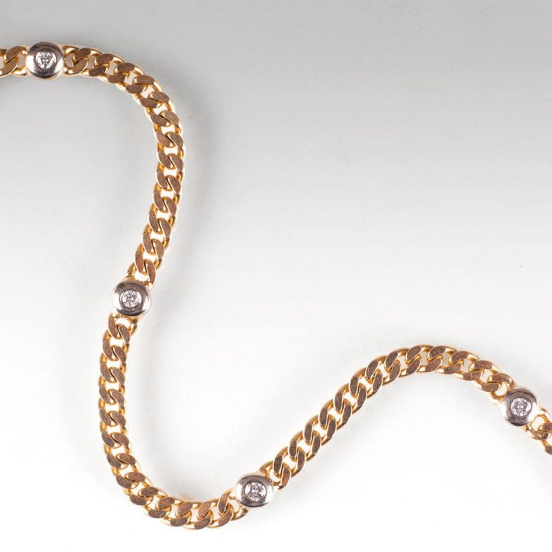A curb chain bracelet with diamonds