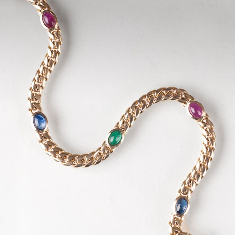 A curb chain bracelet with precious stones