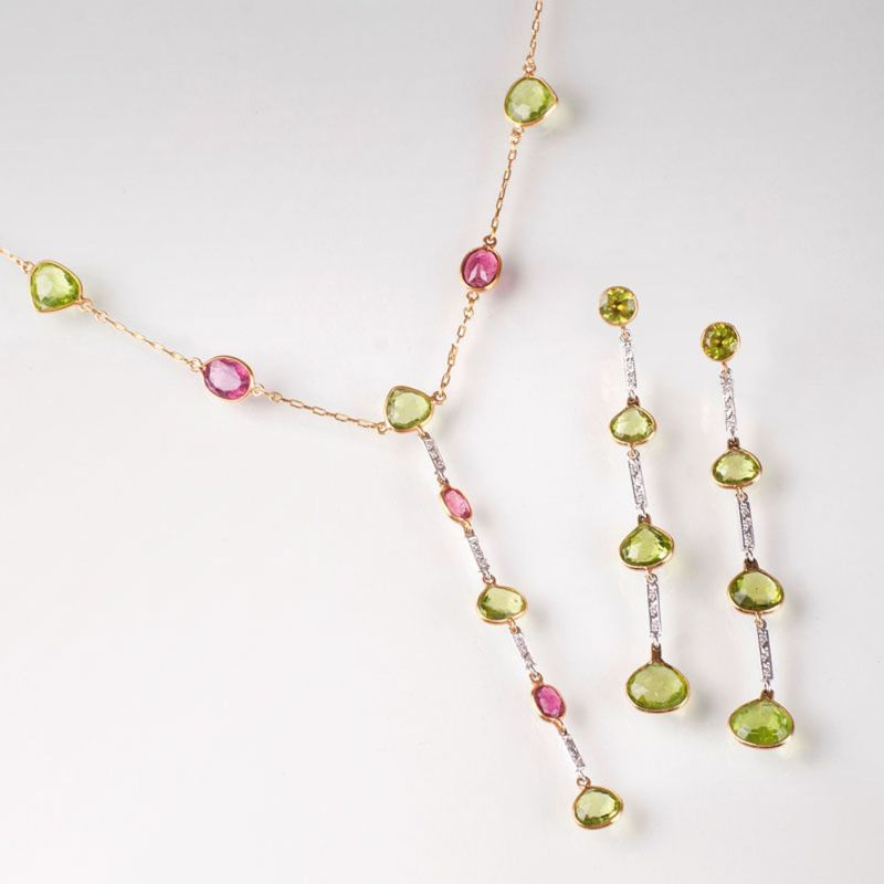 A tourmaline peridot diamond jewellery set with necklace and a pair of earrings