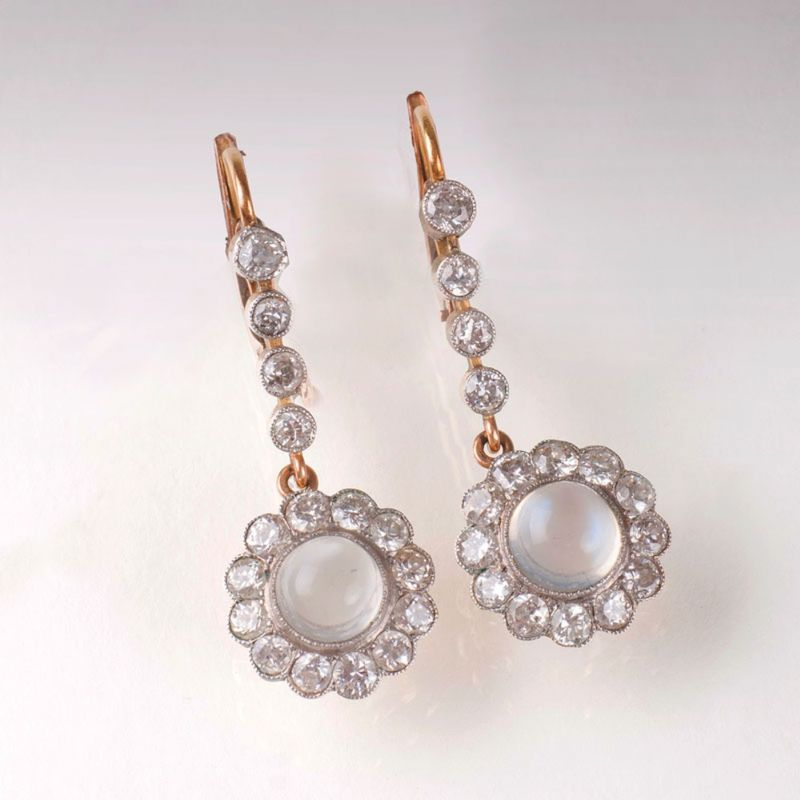 A pairof moonstone earrings with old cut diamonds