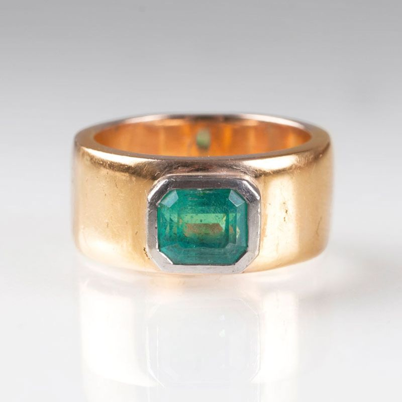 A golden ring with emerald