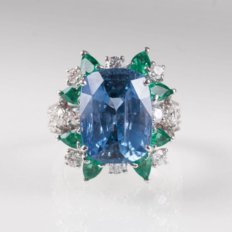 An extravagant sapphire and emerald cocktail ring