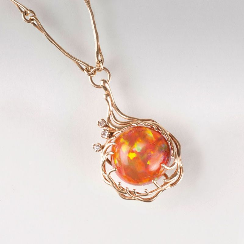 A fire opal diamond pendant with necklace