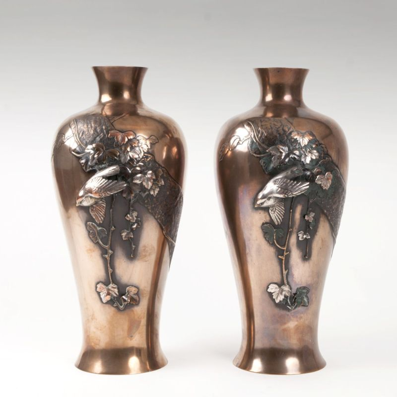A pair of large baluster-shaped multicolored vases with magnificent relief decor