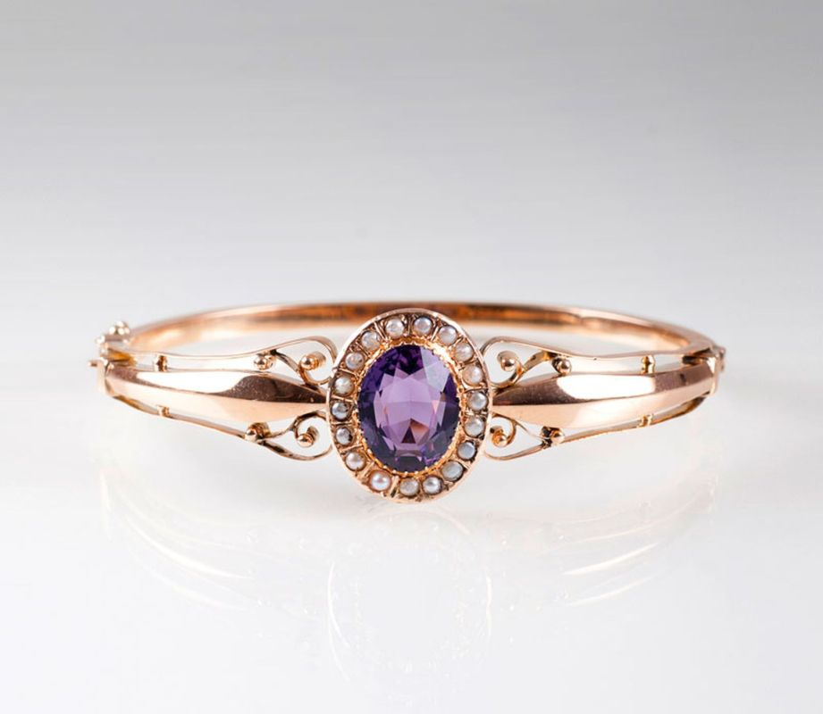 An Art Nouveau bangle bracelet with amethyst and seed pearls