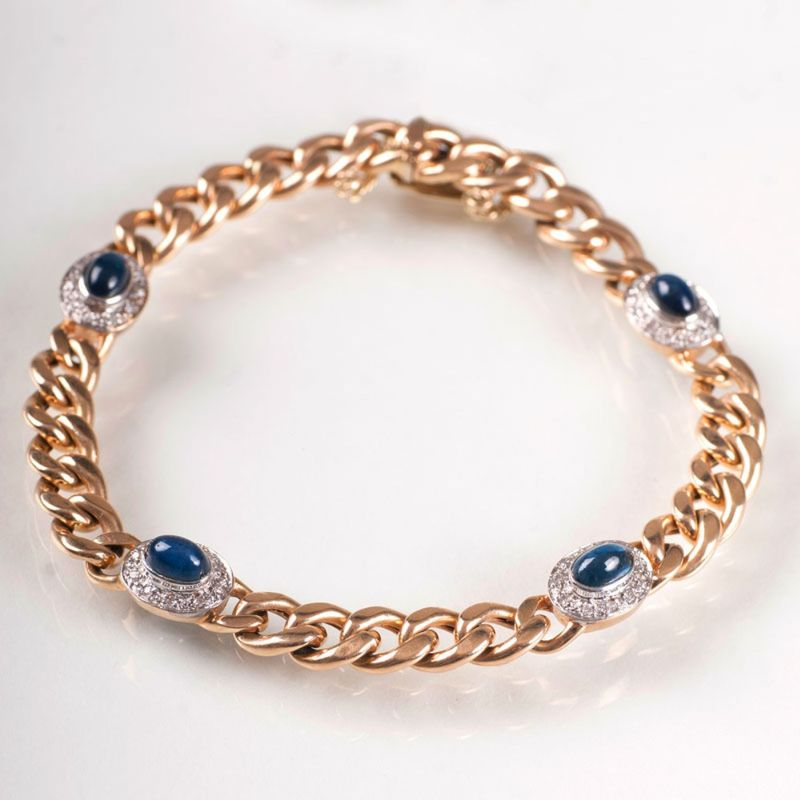 A curb chain bracelet with sapphire cabochons and diamonds