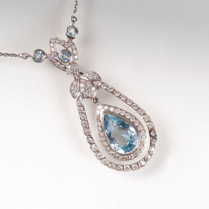 A aquamarine diamond necklace in the style of Art Nouveau