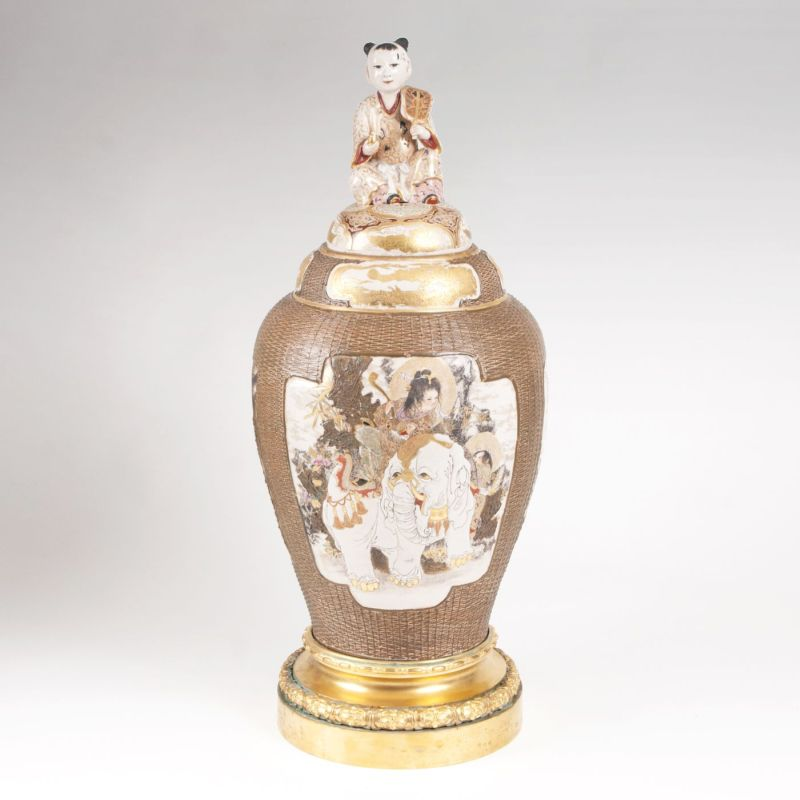 A magnificent Satsuma vase with cover and ormolu mount