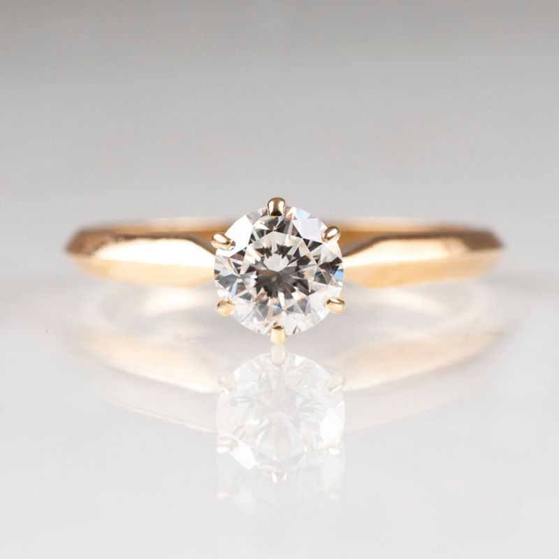 A petite solitaire diamond ring
