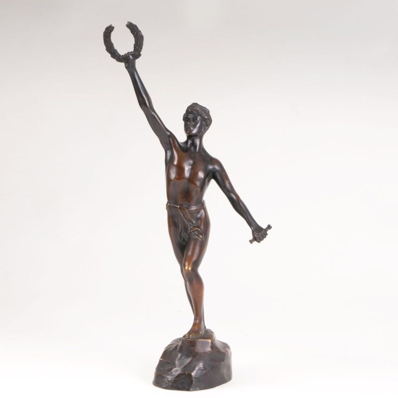 A bronze sculpture 'Young athlete with laurel wreath'