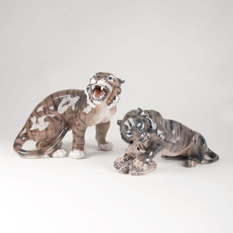 Two porcelain figures 'Roaring or eating tiger'