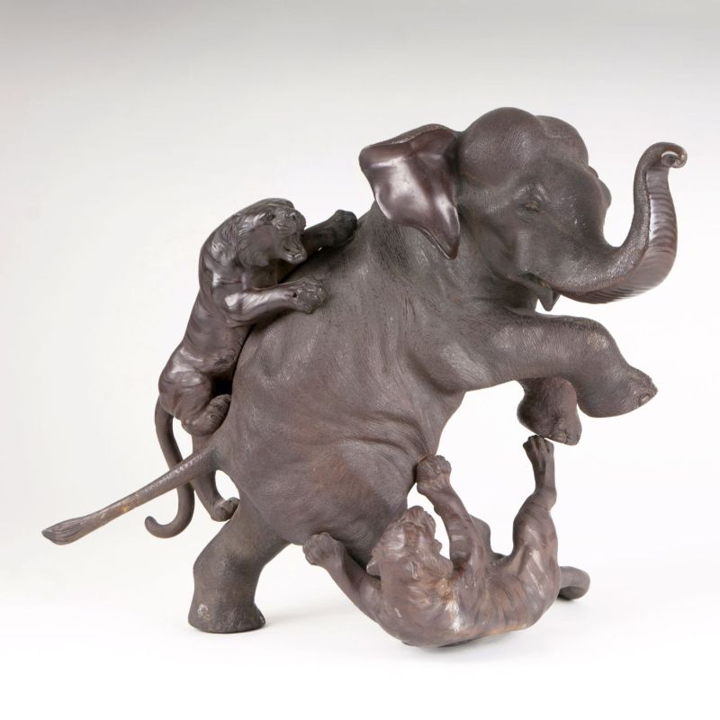 An excellent bronze group 'Elephant attacked by two tigers'