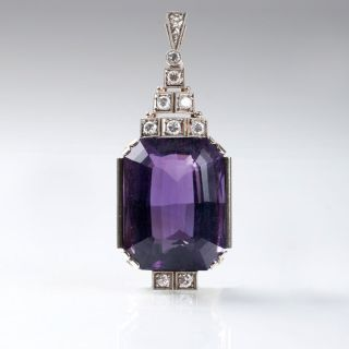 A large Art Déco amethyst pendant with diamonds