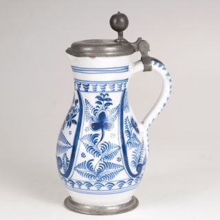 A small fayence pear-shaped jug with blue painting