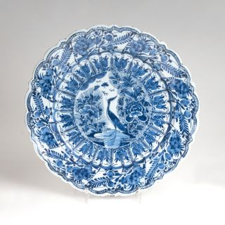 A faience plate with peacock decor