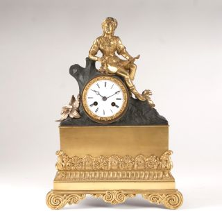 A Louis Philippe mantelclock with cavalier