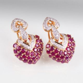 A pair of heart shaped ruby diamond earrings