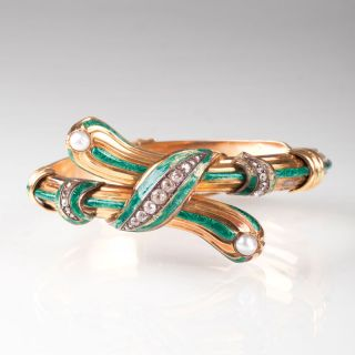 A Fin-de-Siècle enamel bangle bracelet with diamonds and pearls 'Cross Over'