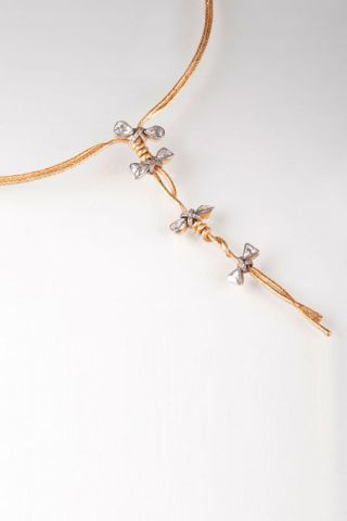 A gold necklace with diamonds