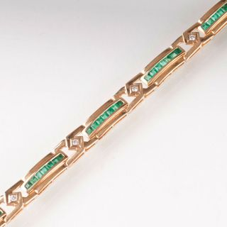 A bracelet with diamonds and emeralds