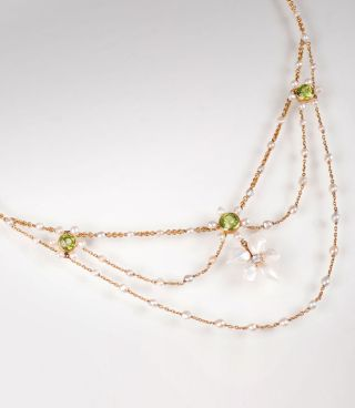 An Art Nouveau necklace with pearls and peridots 'edelweiss'