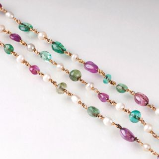 A Vintage sautoir with emeralds, rubes and pearls