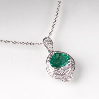 An emerald diamond pendant with necklace