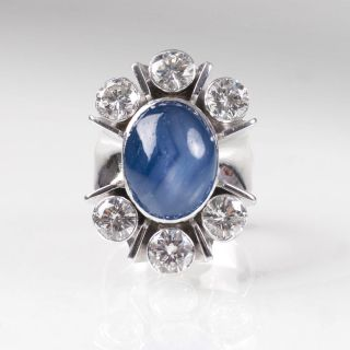 A star sapphire ring with diamonds