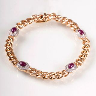A curb chain bracelet with ruby cabochons and diamonds
