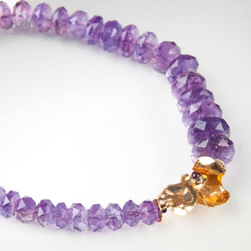 An amethyst necklace with decorative clasp
