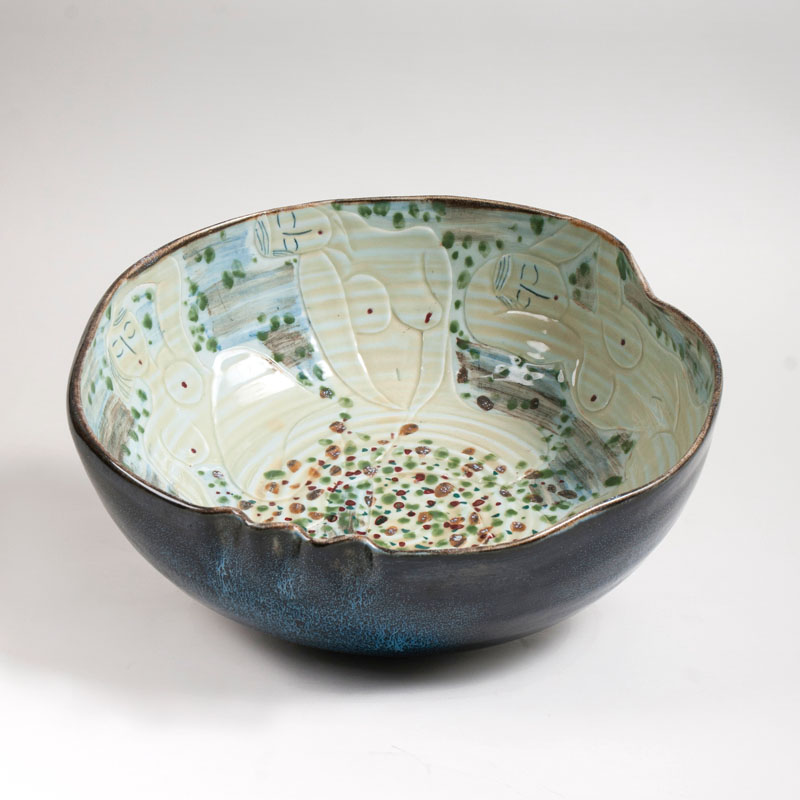 A large modern Chinese porcelain bowl with nude reliefs