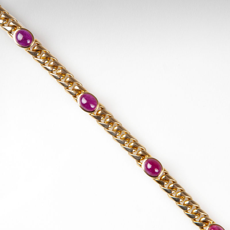 A curb chain bracelet with rubies