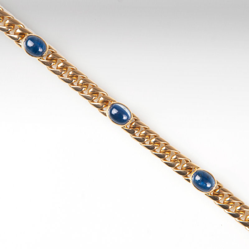 A curb chain bracelet with sapphires