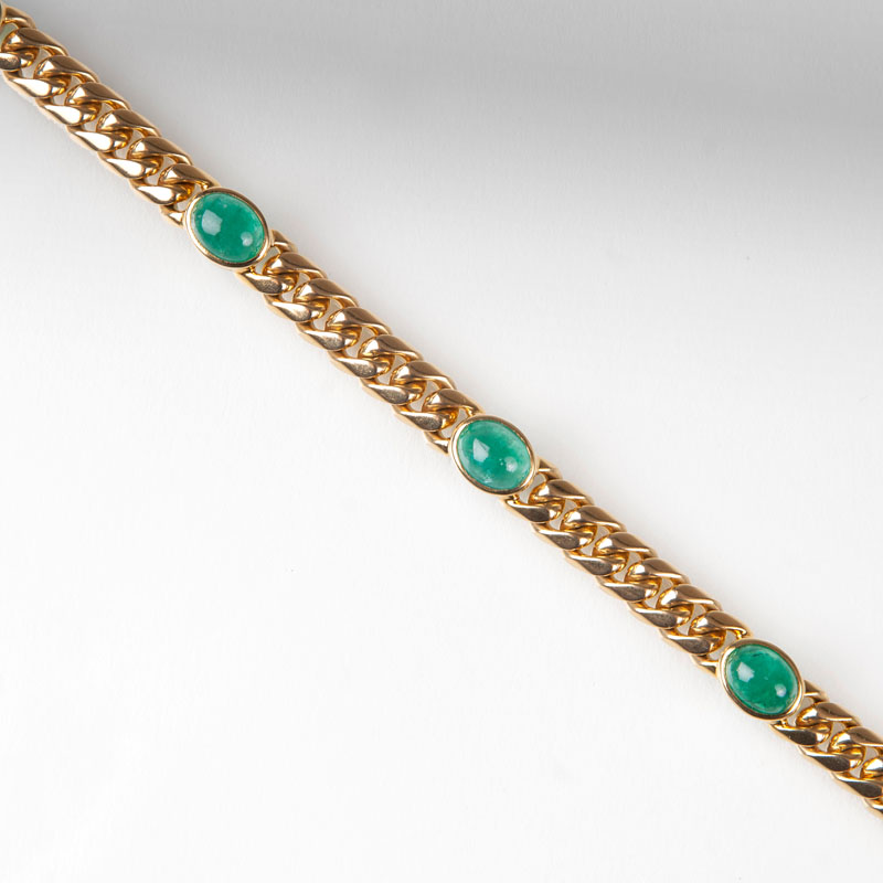 A curb chain bracelet with emeralds